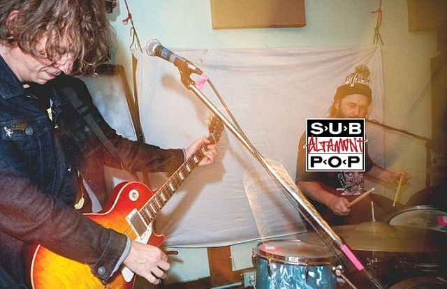Some looks of the Altamont X Sub Pop collection. Altamont's marketing manager, Noel Paris, is on the drums in this pic. Photo courtesy of Altamont.
