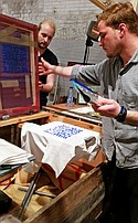 "Bossa Denim was silk-screening T-shirts that read ""Reduce, Reuse, Regenerate, Recycle"" at Blueprint during Denim Days."