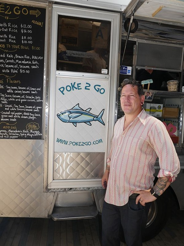 Phillip Dane in front of the Poke 2 Go truck at the CMC.