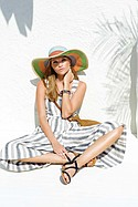AZUL BY MOUSSY patio-striped gaucho romper. ROMY M striped sun hat and rope net bag with leather strap (stylist's own).