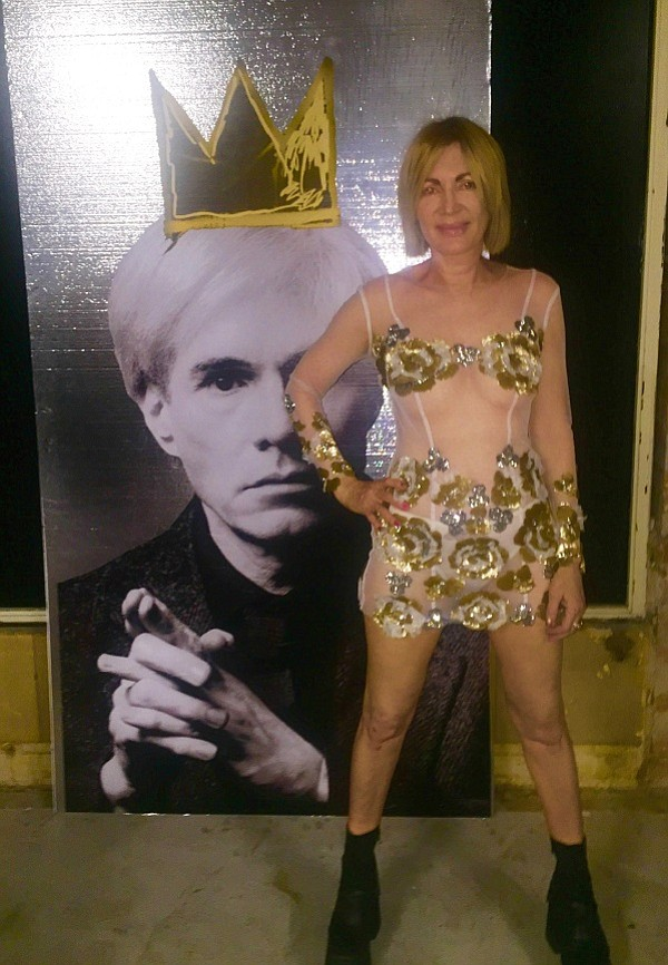 Artist Karen Bystedt, wearing a couture dress by Sonia Ete', pictured with her large crowed Warhol.