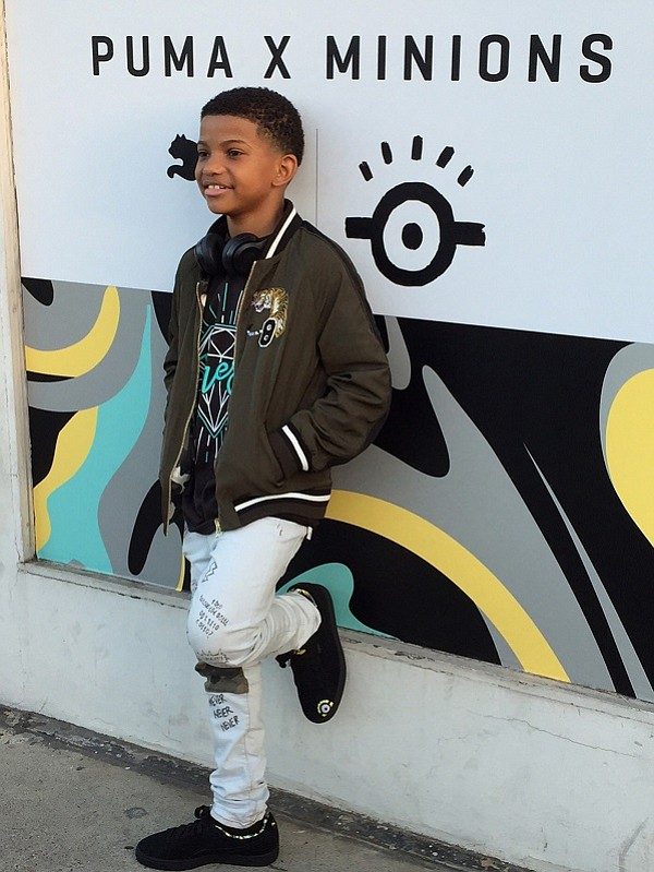 """This Is Us"" actor Lonnie Chavis decked out in his Minions skater shoes for the launch party"