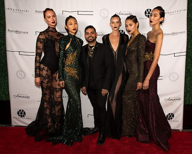 Michael Costello, center, with models wearing Michael Costello dresses, at debut party for his store. Picture by Michael Julius @michaeljulius.
