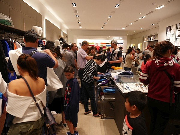 Black Friday crowds at the Lacoste boutique at South Coast Plaza in Costa Mesa, Calif.