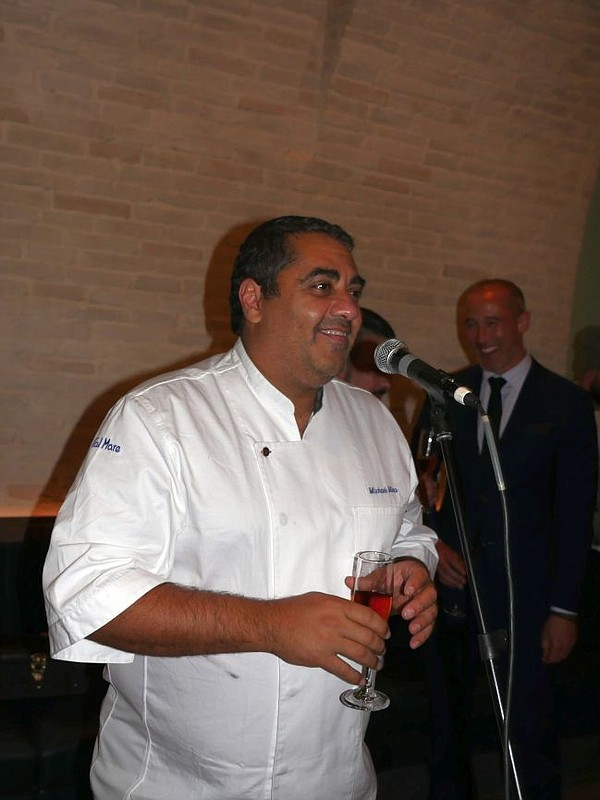 Chef Michael Mina makes a toast to Cal Mare on Nov. 30.