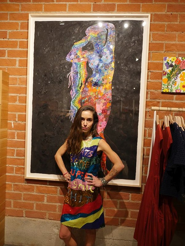 Lola Rose Thompson in front of one of her paintings at the Gorman boutique in West Hollywood.