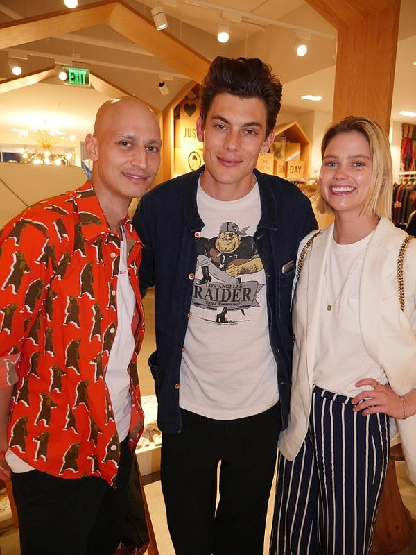 Daniel Hettmann, Band of Outsiders' brand director, left with Nick Lacy and Jessica Morrow, who are modeling the brand's clothes at the Band's Fred Segal pop-up.