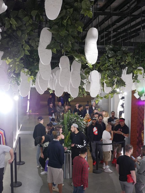Under a ceiling of hanging sneakers, crowds shop at Kith Feb. 19