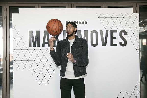 The Lakers'  Brandon Ingram Wearing Express Black Distressed Denim Trucker Jacket and Express Jeans. Image courtesy of Express.