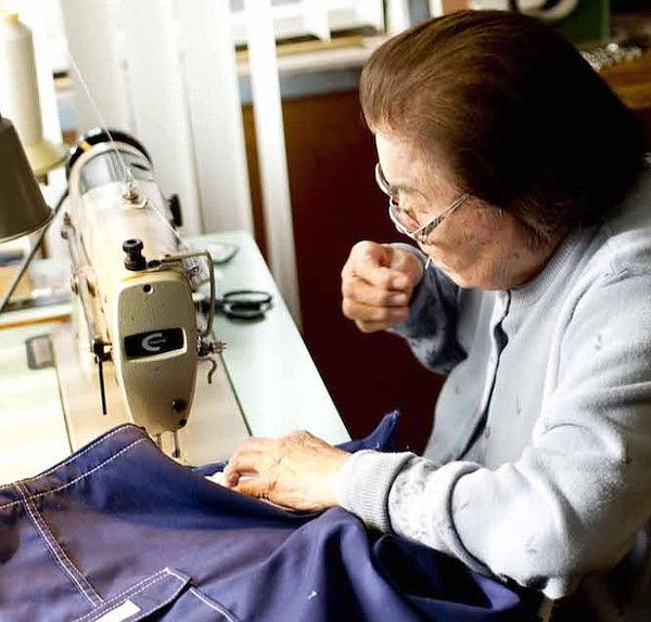 Sato Hughes sewing custom boardshorts. All photos courtesy of Katin