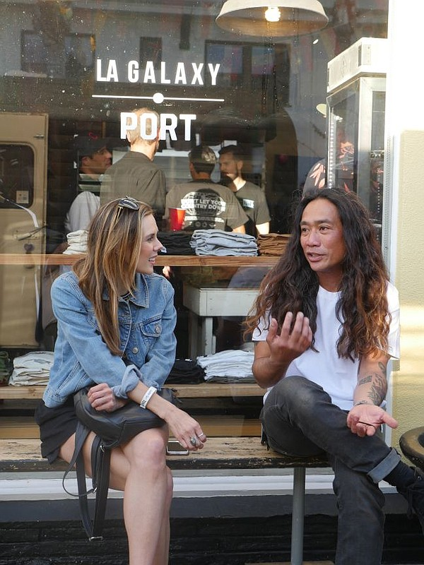Jana Lacey Montalbano and Eric Basangan of the Polymer brand at the Pow! Wow! Long Beach party at Port