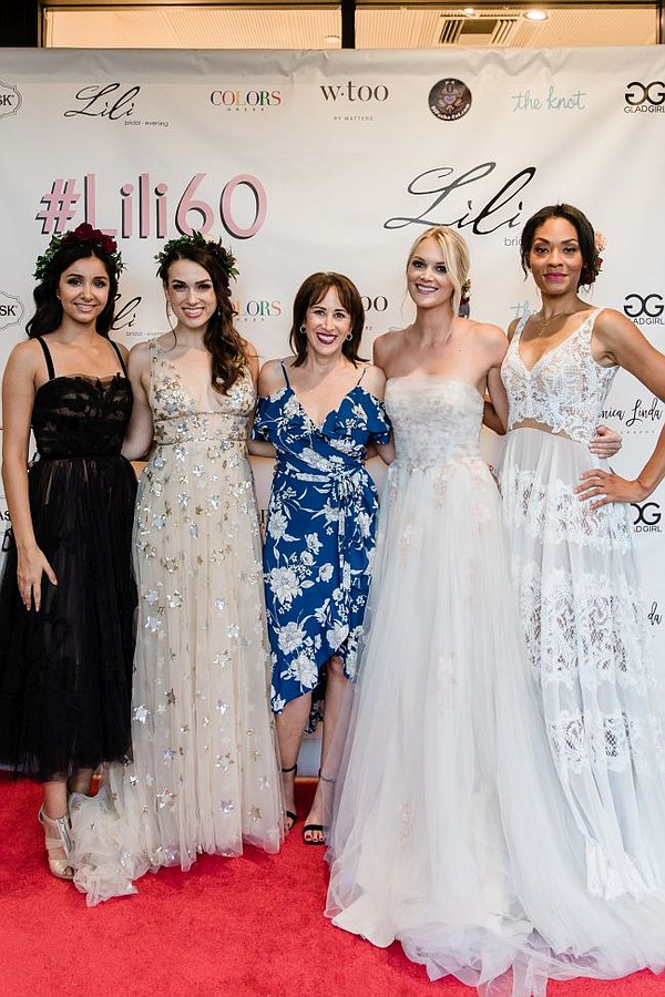 Lisa Litt, middle, with models wearing Wtoo by Watters. Image courtesy Lili's Bridal