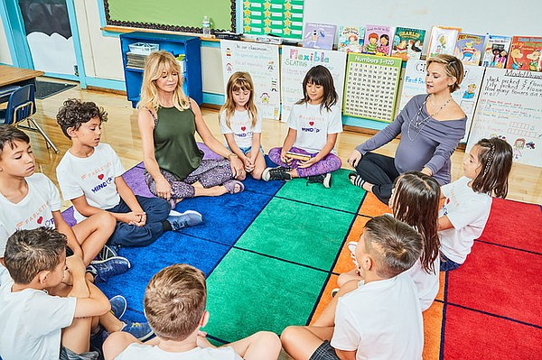 Wearing pieces from the Fabletics x MindUP capsule collection, Goldie Hawn and Kate Hudson visit students from the Carpenter School in Studio City, Calif., which uses the MindUP curriculum.  Photo: Fabletics