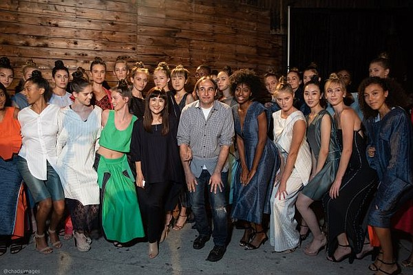 Vicken Derderian and Kyung Hwa Kim, center, take a bow after the Sept. 29 fashion show. All images by Chad Alan