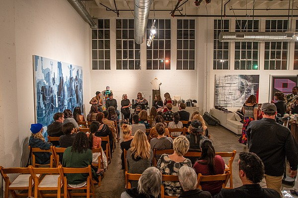 Rachael Staudt, the founder of FiberGirl Designs, speaks during the designers' panel. Photo: Kris Kish