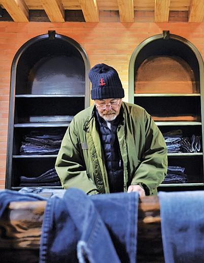Adriano Goldschmied inspects denim at the Blue Diamond Denim showroom.