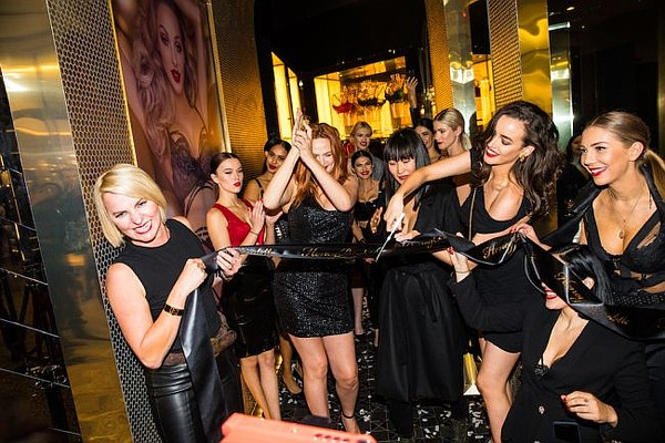 Eloise Monaghan, at bottom left, at a ribbon cutting for Honey Birdette's opening at Westfield Century City. Pictures courtesy of Honey Birdette