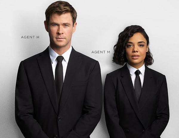 Chris Hemsworth and Tessa Thompson in Paul Smith's black suit. Image via paulsmith.com/us