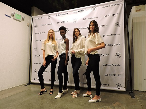 Models wearing Alkhemist apparel