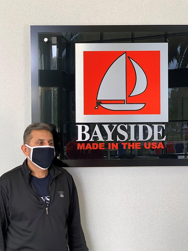 AST Sportswear/Bayside Apparel Chief Operating Officer Abdul Rashid wears a mask manufactured by the company.