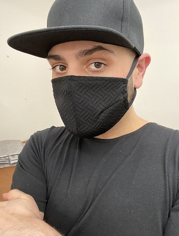 Michael Costello with a face mask that he designed. Image courtesy Michael Costello