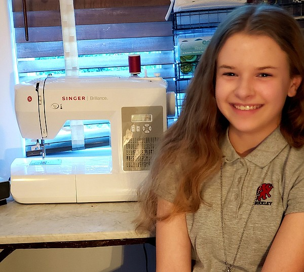 Madeleine Fugate with her sewing machine
