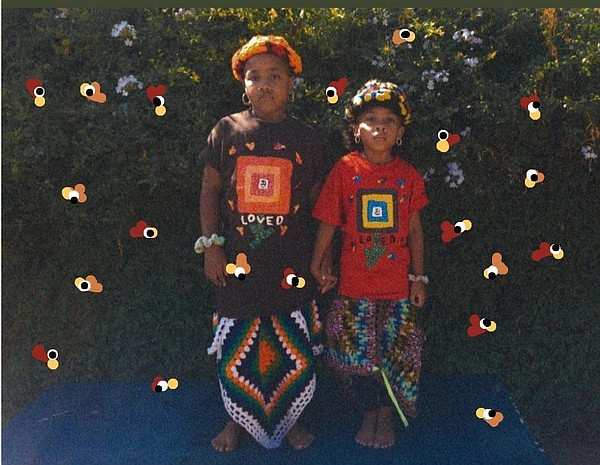 Nicholas Mayfield's goddaughters, Chloe (left) and Madison Morgan, model pieces from his collaboration with Yarn Movement.