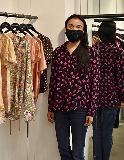 Catherine Gee stands beside her Spring 2021 collection during L.A. Market at the Cooper Design Space. | Photo courtesy of Catherine Gee