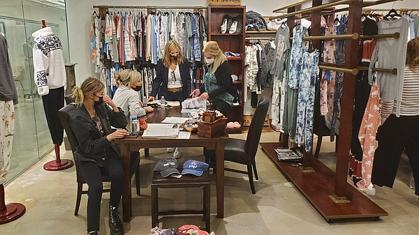 During L.A. Market Week, buyers visited buildings in the downtown Los Angeles fashion district for in-person appointments, such as this meeting at the Rande Cohen Showroom in The New Mart. 