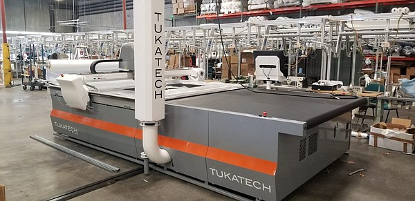 Levi's largest supplier of knit garments, Combined Fabric, recently added a third Tukatech automatic high-ply cutter.   Image: Tukatech