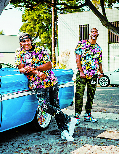 """What began as a mural by artist Ruben Rojas in 2018 evolved into a T-shirt line, and now the brand includes tank tops, hoodies, joggers, bra tops, shorts, leggings, hats, masks and even a 14-karat-gold necklace and earrings—all to spread the """"love."""""""