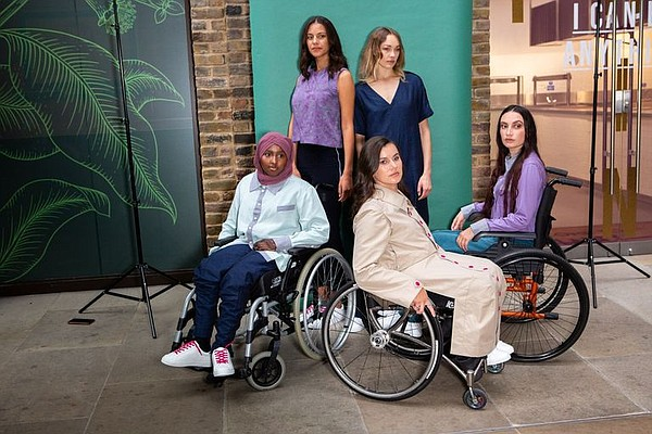 Models prepare to showcase the adaptive-fashion collection by Faduma's Fellowship and winner Harriet Eccleston during London Fashion Week. From left, in the back row, Alix Landais and Eleanor Davies. Front row from left, Najmah Samantar, Ella Beaumon and Lauren N. Photo: Faduma's Fellowship
